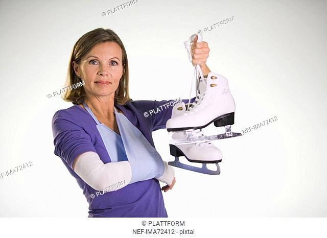 An injured woman holding skates