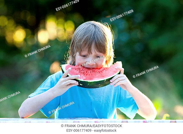 Boy Eating Watermelon Outdoors