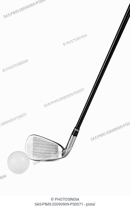 Close-up of a golf club with a golf ball