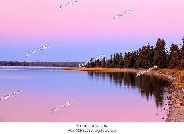 Clear Lake shoreline at dawn in late autumn. Riding Mountain National Park, Manitoba, Canada