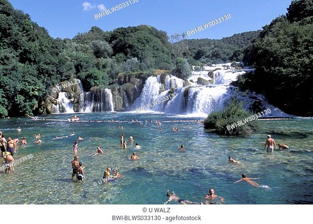 Krka waterfalls with bathing people, Croatia