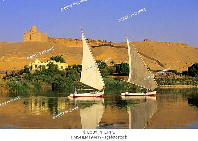 Egypt, Upper Egypt, Aswan, feluccas on Nile River, Aga Khan Mausoleum in the background