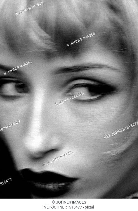 Young woman face, defocused