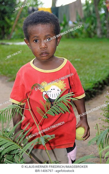 Dani boy in a T-shirt, Wamena, Irian Jaya or West Papua, New Guinea, Indonesia, Southeast Asia