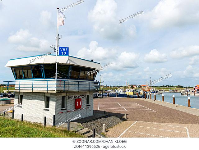 Harbour of the fishing village Oudeschild with harbour office on the isle of Texel