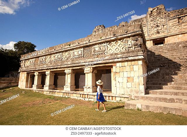 Tourist at the Quadrangle Of The Nuns in Uxmal Ruins, Uxmal, Yucatan Province, Mexico, Central America