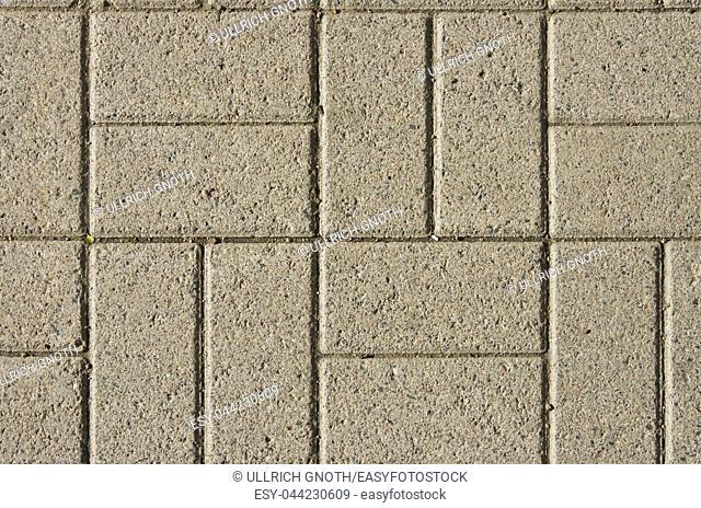 Pattern of rectangular promenade tiles of concrete