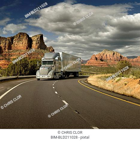 Semi truck driving through desert, Sedona, Arizona, United States