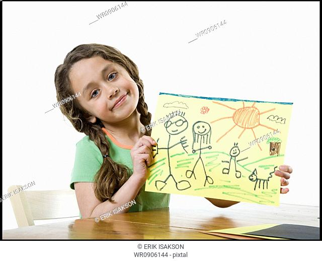 Portrait of a girl showing a drawing
