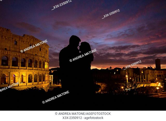 Couple silhouette at sunset. Roman Colosseum. Rome, Italy