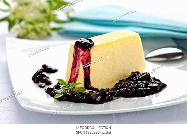 Elderflower parfait with stewed damsons and plums