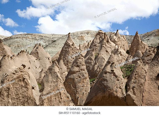 As a result of the Erciyes Volcano eruption, thousands of years ago, a hard cap rock was created on tall pillar and formed the fairy chimneys