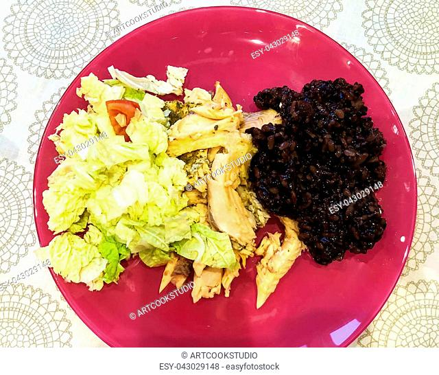 Healthy Eating. Steamed fish fillets and black rice. Studio Photo
