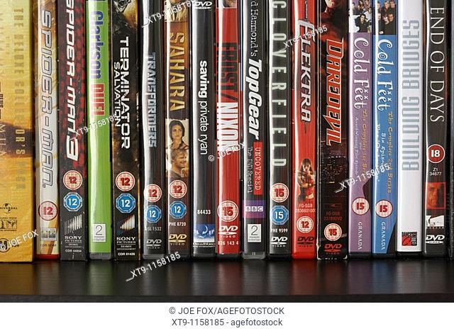 row of dvd video cases on a shelf showing a range of BBFC and irish film censors office classification notices from the uk