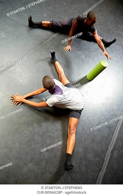 Dancers doing stretching exercise