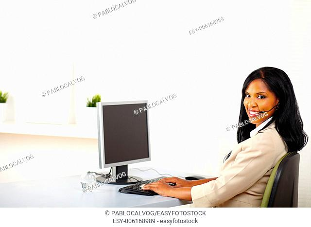 Portrait of a young attractive call center operator at work