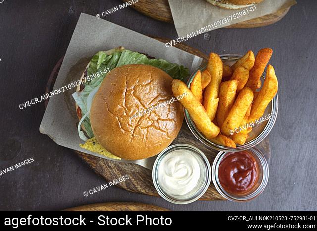 Aerial view of hamburger with french fries on restaurant table