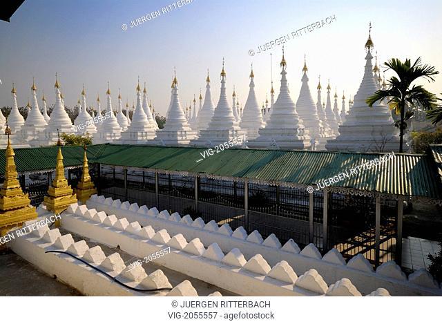 ASIA, MYANMAR, BURMA, BIRMA, MANDALAY, AMARAPURA, SANDAMANI PAGODA with many small white stupas - MANDALAY, AMARAPURA, MYANMAR, 31/03/2010