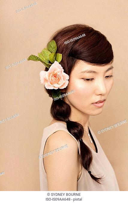 Mid adult woman wearing flower in hair