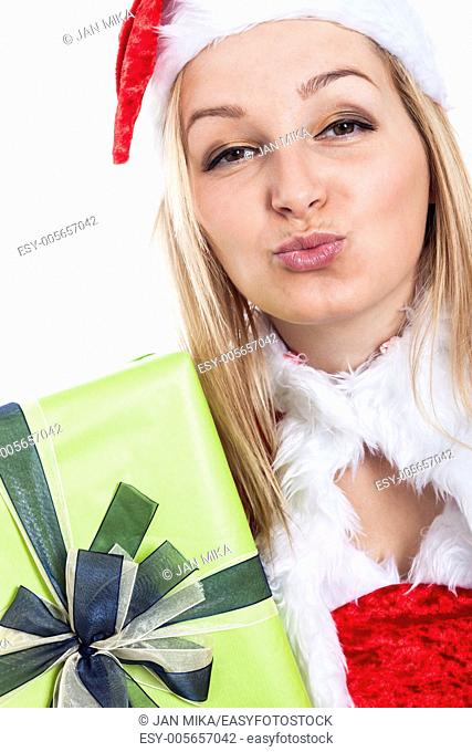Closeup of thankful Christmas woman sending kiss