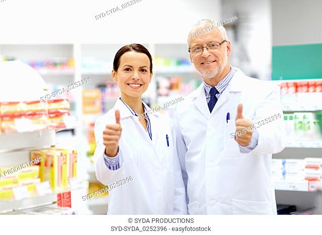 happy apothecaries showing thumbs up at pharmacy