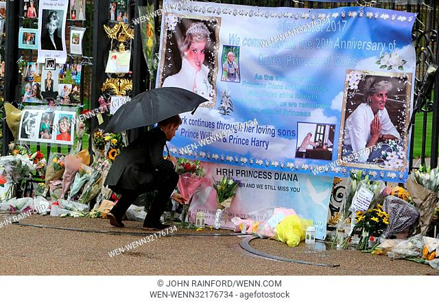 Prince William, Duke of Cambridge and Prince Harry read tributes left at Kensington Palace gates ahead of tomorrow's 20th anniversary of their mother's death