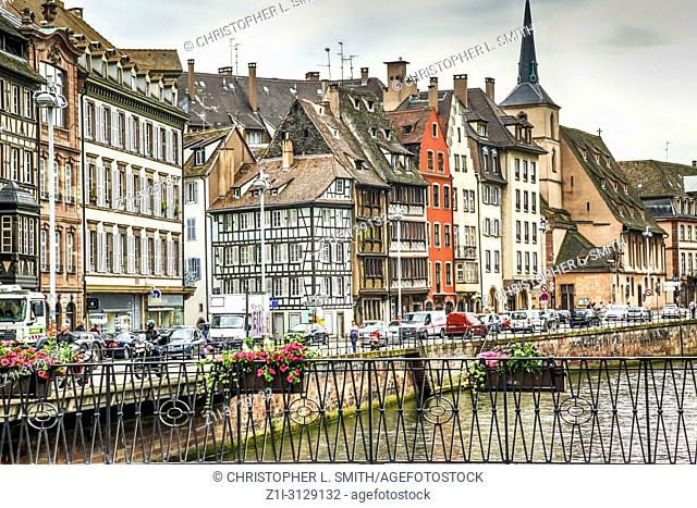 Looking across the River Ille to the Quai Desaix in the Petit France district of Strasbourg France