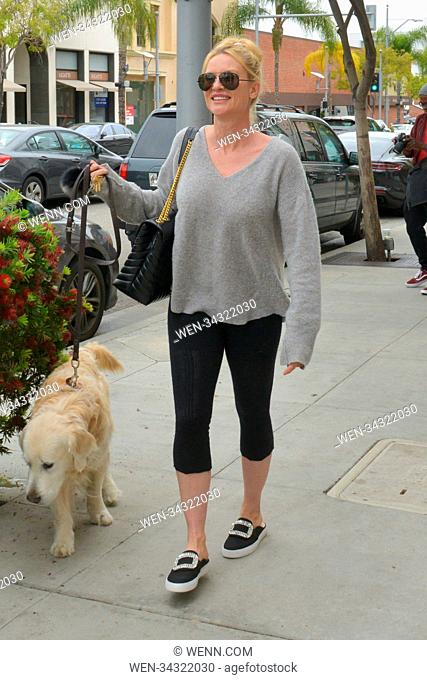 """Nicollette Sheridan Walking Her Dog In Beverly Hills after enjoying lunch at """"""""E. Baldi"""""""" restaurant. Featuring: Nicollette Sheridan Where: Beverly Hills"""