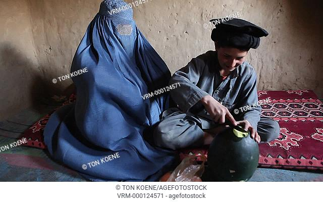 Afghan boy and his mother in a slum in Kabul