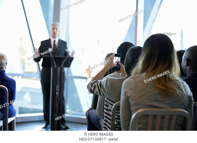 Audience watching politician speaking at political rally