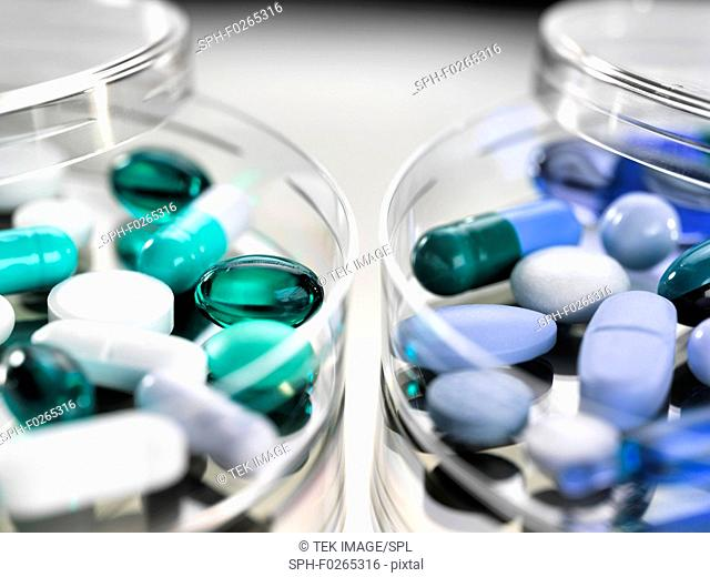 Pharmaceutical research, conceptual image. A variety of medicines sitting in a petri dish
