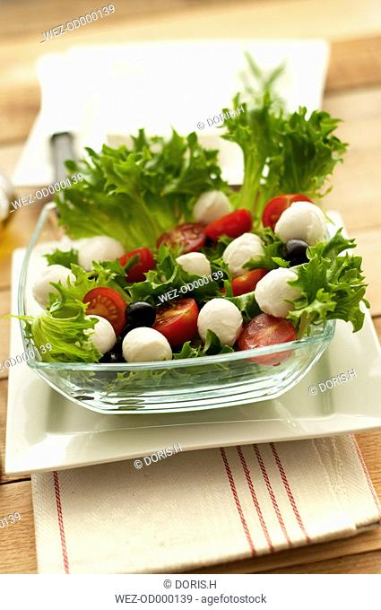 Plate of salad with tomatoes and mozzarella, close up