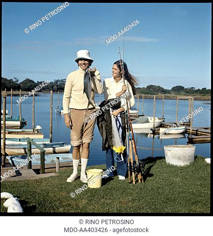 Christiaan Barnard and his wife Barbara Zoellner fishing. South African surgeon Christiaan Barnard showing a freshly caught fish under the pleased gaze of his...
