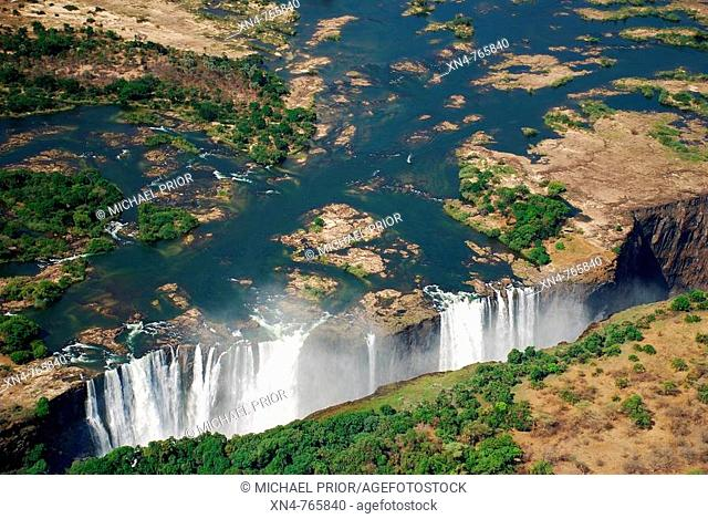 victoria falls from the air, waterfall of the zambezi river flowing from zambia to zimbabwe