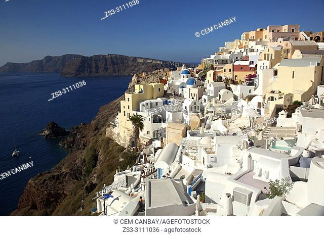 View to the traditional houses and churches in Oia town with Caldera at the background, Santorini, Cyclades Islands, Greek Islands, Greece, Europe