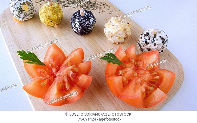 Tomatoes with spiced goat cheese balls