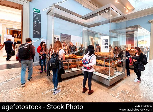 London, United Kingdom - May 13, 2019: The British Museum, London. Hall of Ancient Egypt, artifacts, busts and statues with visitors and tourists admiring the...