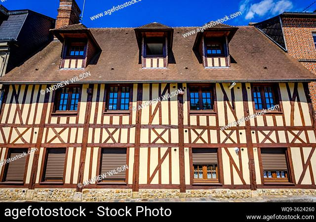 Street scene in the town of Bernay, Normandy, France featuring typical Norman architecture