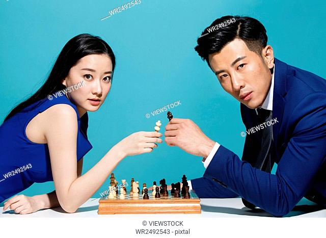 Young business men and women chess