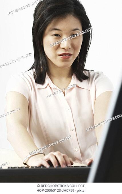 Portrait of a businesswoman using a computer
