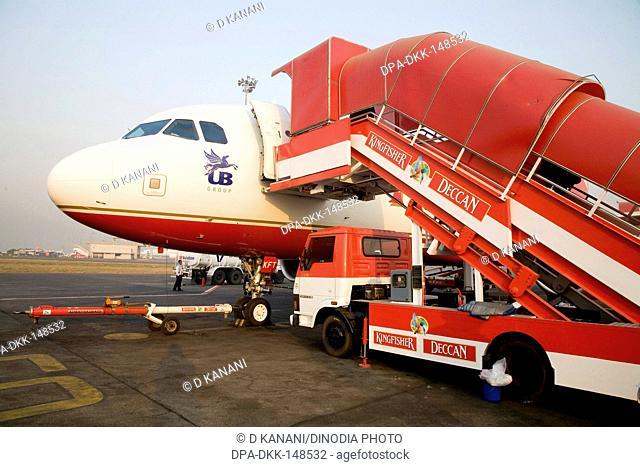 Kingfisher Deccan flight air bus A320 is preparing to take off on runway at Chattrapati Shivaji Terminal ; Santacruz ; Bombay now Mumbai ; Maharashtra ; India