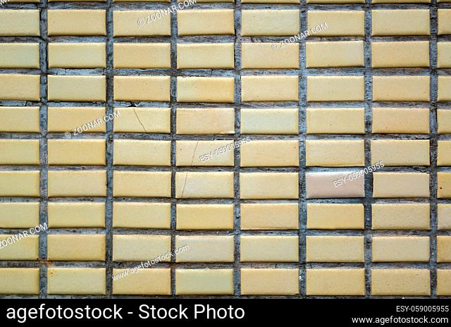 real yellow porcelain tile wall background with good detail