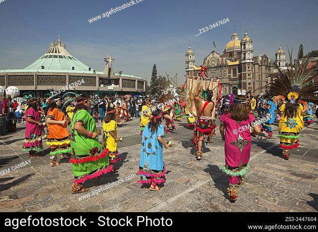 Indigenous dancers in traditional costumes perform at the pilgrimage to Our Lady of Guadalupe Basilica during the Virgen de Guadalupe Festival in Mexico City