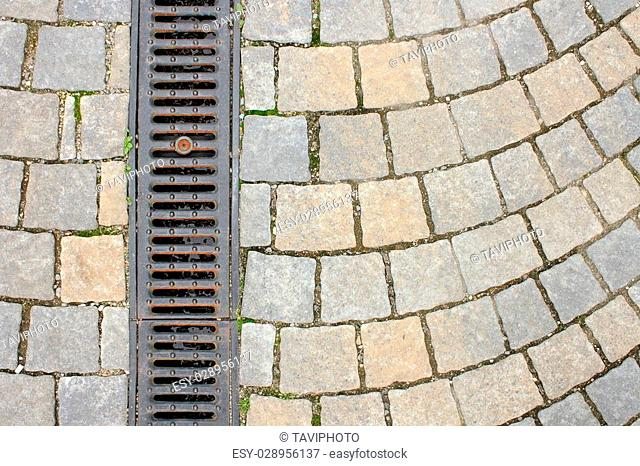 drainage on stone paved street, textured view