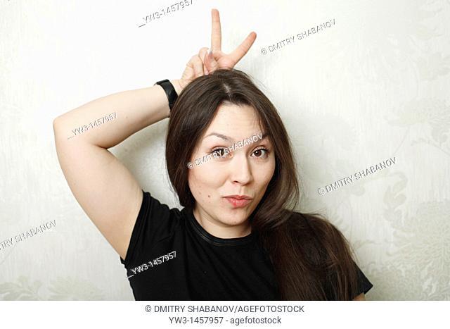 horns of hends - women grimasing headshot