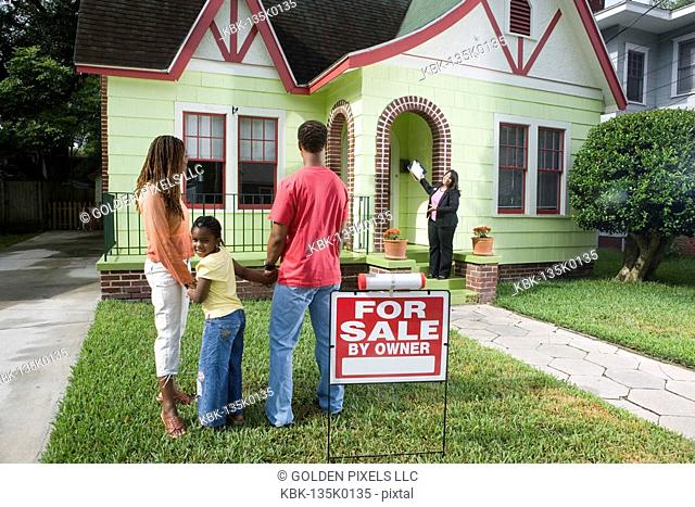 Real estate broker showing house to buyers