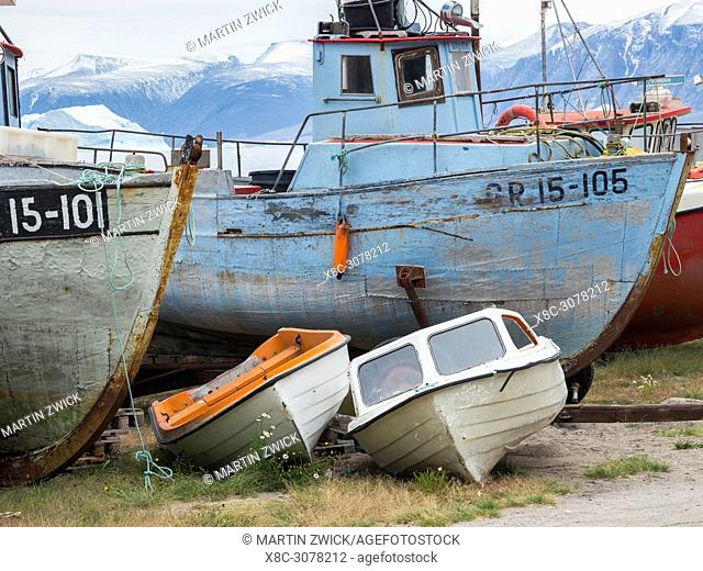 The harbour with typical fishing boats. Small town Uummannaq in the north of west greenland. America, North America, Greenland, Denmark