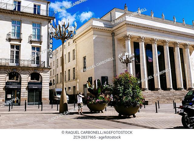 Tourist taking pictures of Theater Graslin next to in Graslin Place square, Nantes, Loire-Atlantique, Pays de la Loire, France