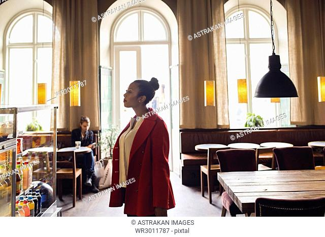 Woman standing in cafeteria