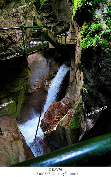 Roaring waterfall of the Pioverna river that forms the Bellano gorge,near Como Lake,Italy